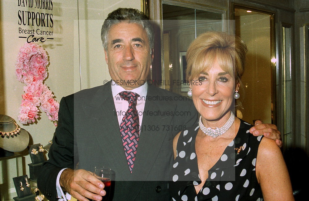 MR & MRS DAVID MORRIS, he is the jeweller, at a party in London on 9th June 1997.LZB 4