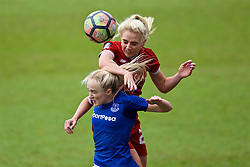 BIRKENHEAD, ENGLAND - Sunday, April 29, 2018: Liverpool's Alex Greenwood and Everton's Faye Bryson during the FA Women's Super League 1 match between Liverpool FC Ladies and Everton FC Ladies at Prenton Park. (Pic by David Rawcliffe/Propaganda)