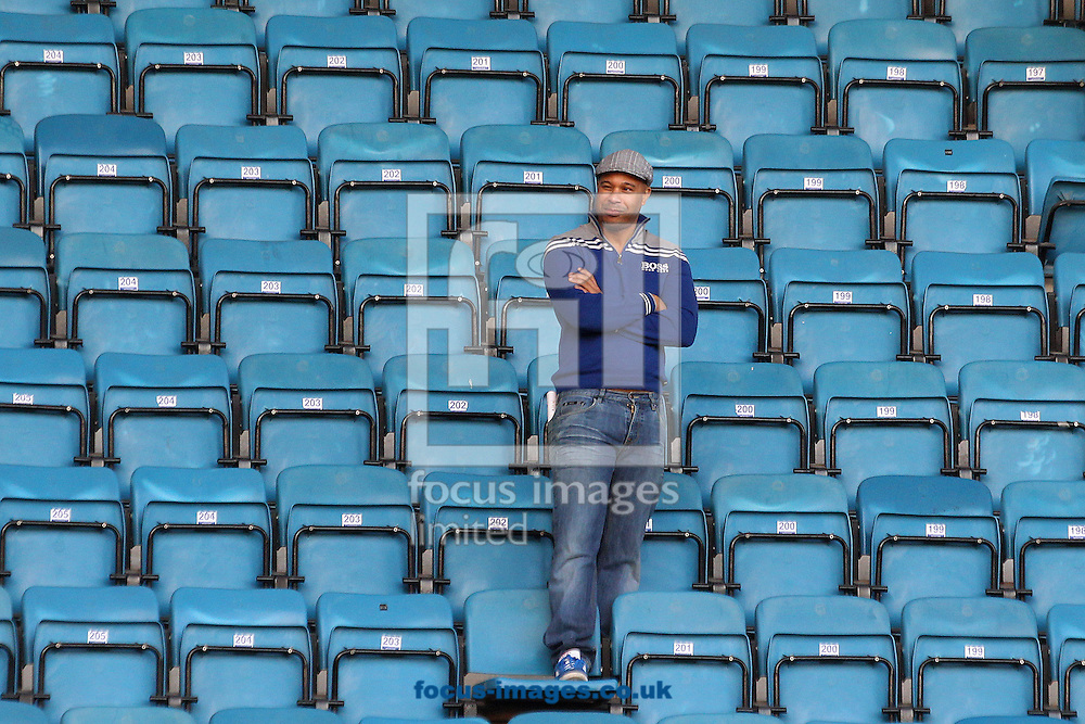 A loan Millwall fan wathces the the traveling Norwich fans during the Sky Bet Championship match at The Den, London<br /> Picture by Paul Chesterton/Focus Images Ltd +44 7904 640267<br /> 07/03/2015