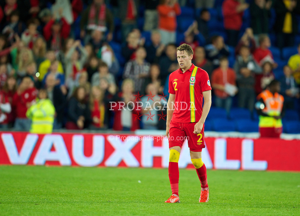 CARDIFF, WALES - Tuesday, September 10, 2013: Wales' Chris Gunter looks dejected after his side's 3-0 defeat by Serbia during the 2014 FIFA World Cup Brazil Qualifying Group A match at the Cardiff CIty Stadium. (Pic by David Rawcliffe/Propaganda)