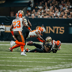 Sep 16, 2018; New Orleans, LA, USA; Cleveland Browns safety Derrick Kindred (26) forces a fumble by New Orleans Saints wide receiver Ted Ginn Jr. (19) during the second quarter of a game at the Mercedes-Benz Superdome. Mandatory Credit: Derick E. Hingle-USA TODAY Sports