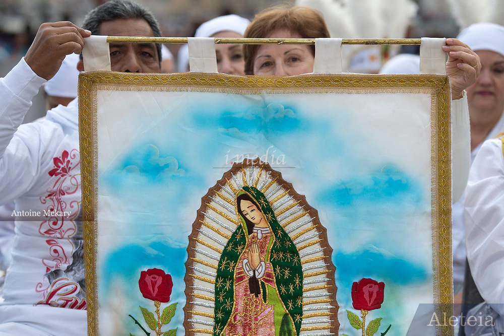 VATICAN CITY, ITALY 27 SEPT 2017: A group of Mexican Pilgrims greet Pope Francis with a tapestry of Our Lady of Guadalupe at the General Audience in St. Peters Square on Sept. 27, 2017