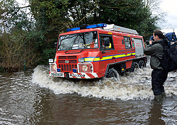 An emergency rescue vehicle makes it's way through flood hit Wraysbury, United Kingdom, Tuesday, 11th February 2014. Picture by David Dyson / i-Images
