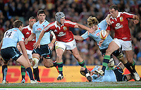 15 June 2013; Jonathan Davies, British & Irish Lions, is tackled by Pat McCutcheon and Rob Horne, NSW Waratahs. British & Irish Lions Tour 2013, NSW Waratahs v British & Irish Lions, Allianz Stadium, Sydney, NSW, Australia. Picture credit: Stephen McCarthy / SPORTSFILE