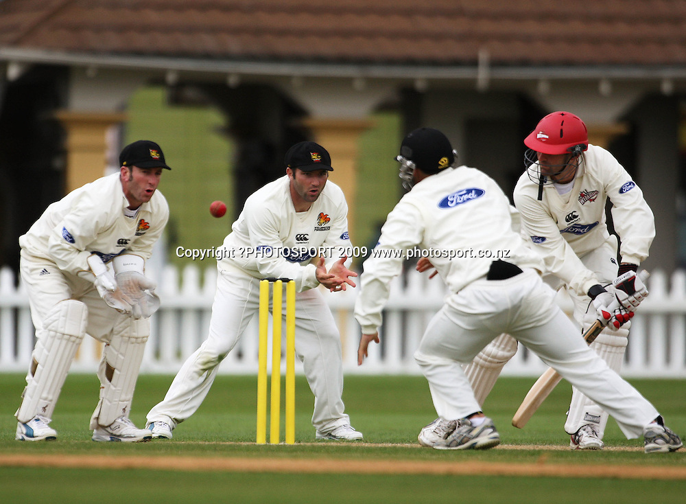 Canterbury's Andrew Ellis plays a shot as Chris Nevin and Luke Woodcock look on.<br /> Plunket Shield cricket - Wellington Firebirds v Canterbury Wizards at Allied Nationwide Finance Basin Reserve, Wellington. Friday, 13 November 2009. Photo: Dave Lintott/PHOTOSPORT