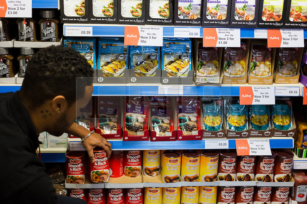 "© Licensed to London News Pictures. 19/12/2014. London, UK. A man browses discounted products in the Community Shop. The Community Shop opened this week in Gipsy Hill, South London and is a ""social supermarket"", which sells heavily-discounted surplus food that would otherwise be thrown away. Food is received from retail brands such as Marks & Spencer, Asda, Tesco, Innocent and Muller and many more. The shop works on a membership basis only, serving residents who are on income support and aimed at people who are in work, but low waged and for those working hard to find a job. Photo credit : Vickie Flores/LNP"