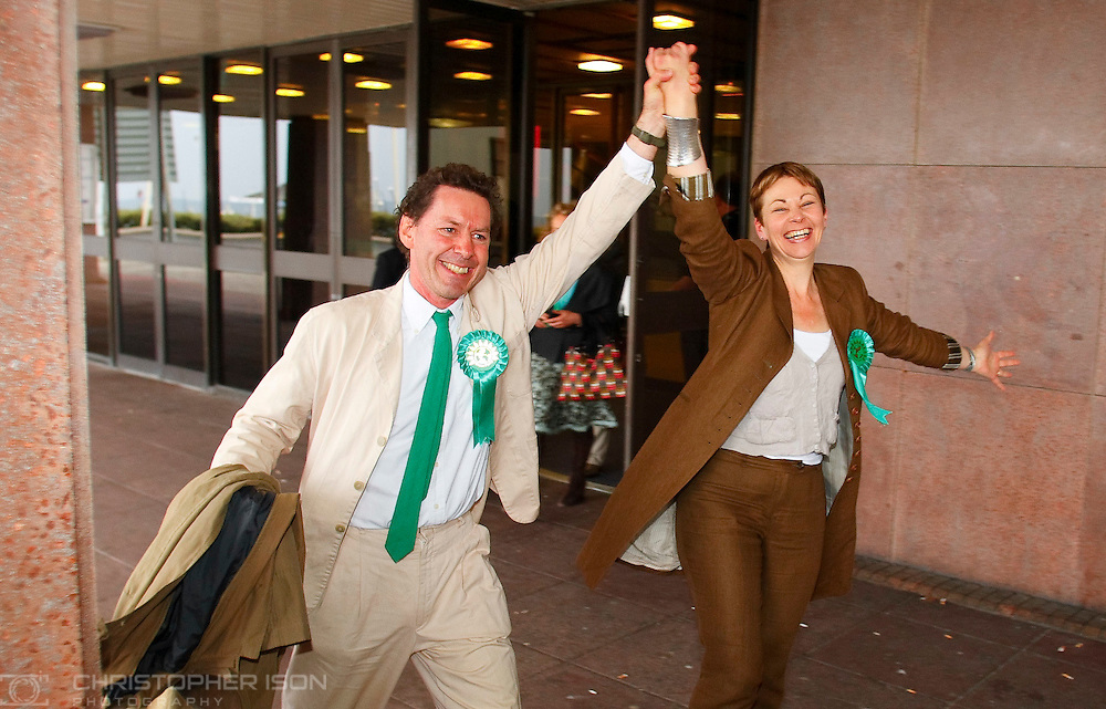 The new Green Party MP, Caroline Lucas, celebrates her victory in the Brighton Pavilion seat with her husband Richard Savage outside the count at the Brighton Centre in East Sussex.