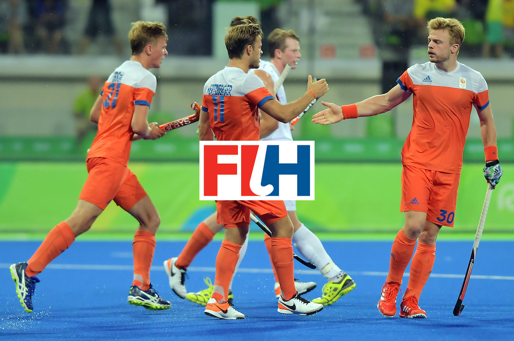 Netherland's Mink van der Weerden (R) celebrates a goal with teammates during the men's semifinal field hockey Belgium vs Netherlands match of the Rio 2016 Olympics Games at the Olympic Hockey Centre in Rio de Janeiro on August 16, 2016.  / AFP / Carl DE SOUZA        (Photo credit should read CARL DE SOUZA/AFP/Getty Images)