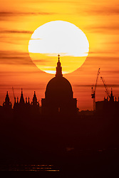 © Licensed to London News Pictures. 13/05/2019. London, UK. The sun sets behind St Paul's Cathedral after a warm day in London. Temperatures are set to rise up to 19 degrees Celsius with clear skies in the capital tomorrow. Photo credit : Tom Nicholson/LNP
