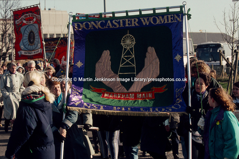 Doncaster WAPC banner on the NUM 'No Pit Closures' march . Doncaster. 27/02/1993.