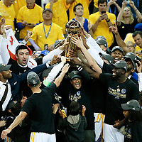 12 June 2017: Celebration with the Larry O'Brien NBA Championship Trophy by owner Peter Guber and the team during the Golden State Warriors 129-120 victory over the Cleveland Cavaliers, in game 5 of the 2017 NBA Finals, at the Oracle Arena, Oakland, California, USA.