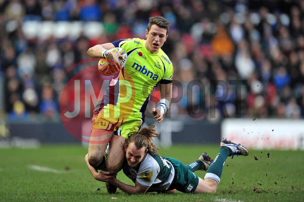Sam James of Sale Sharks is tackled to ground by Sam Harrison of Leicester Tigers - Mandatory byline: Patrick Khachfe/JMP - 07966 386802 - 06/02/2016 - RUGBY UNION - Welford Road - Leicester, England - Leicester Tigers v Sale Sharks - Aviva Premiership.