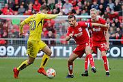 Burton Albion midfielder Luke Murphy (30) battles for possession with Bristol City midfielder Gary O'Neil (6) during the EFL Sky Bet Championship match between Bristol City and Burton Albion at Ashton Gate, Bristol, England on 4 March 2017. Photo by Richard Holmes.