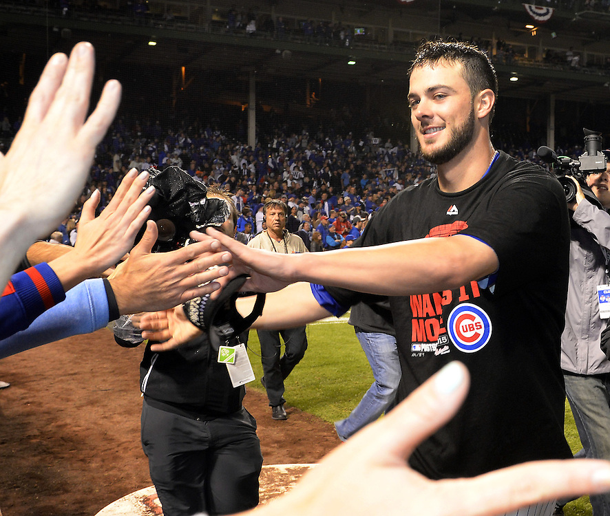 CHICAGO, IL - OCTOBER 12:  Kris Bryant #17 of the Chicago Cubs celebrates with fans after Game 3 of the NLDS against the St. Louis Cardinals at Wrigley Field on Monday, October 12, 2015 in Chicago , Illinois. (Photo by Ron Vesely/MLB Photos via Getty Images) *** Local Caption *** Kris Bryant