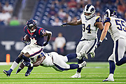 HOUSTON, TX - AUGUST 29:  Steven Mitchell Jr. #11 of the Houston Texans runs the ball and is chased and tackled by Marquise Copeland #93 and John Franklin-Myers #94 of the Los Angeles Rams during week four of the preseason at NRG Stadium on August 29, 2019 in Houston, Texas. The Rams defeated the Texans 22-10.   (Photo by Wesley Hitt/Getty Images) *** Local Caption *** Steven Mitchell Jr.; John Franklin-Myers; Marquise Copeland