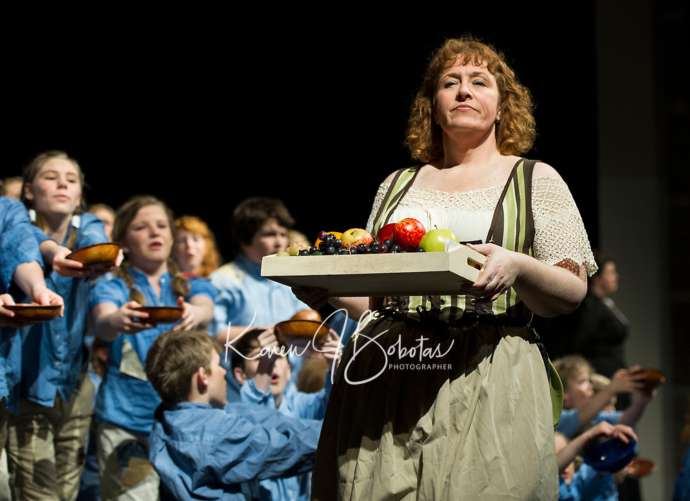 "The workhouse children plead for food only to be ignored by towns person (Jessica Alward) during Thursday evening's dress rehearsal of ""Oliver"" with the Streetcar Company.  (Karen Bobotas/for the Laconia Daily Sun)"