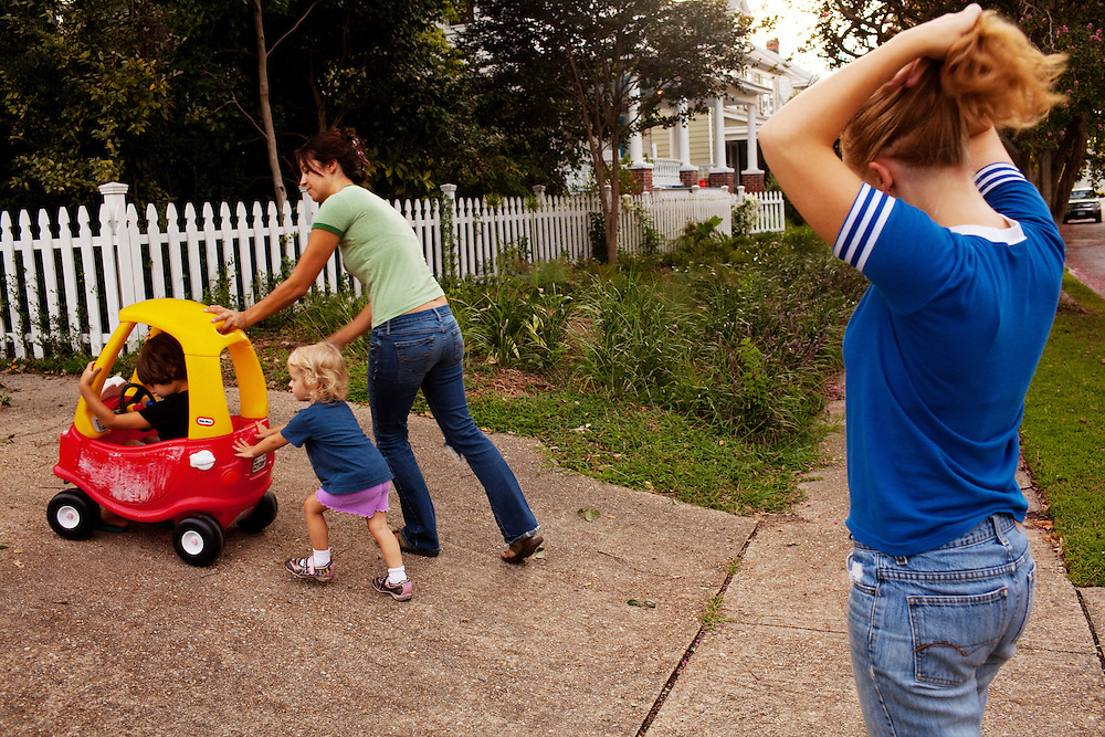 Melissa Eich (R) pulls up her hair while her daughter Madelyn Avery Eich, 2, pushes her friend Beckham with assistance from his mother Ashley on the afternoon of Friday, September 3, 2010 in Norfolk, Virginia.
