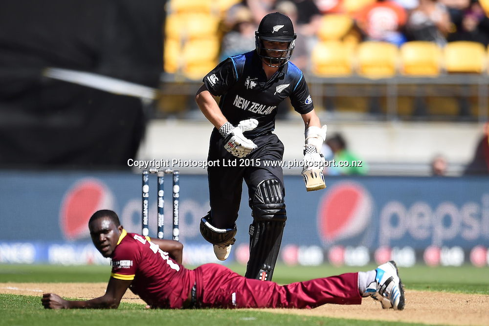 New Zealand batsman Kane Williamson plays a straight drive past bowler Jerome Taylor during the ICC Cricket World Cup Quaterfinal match between New Zealand and West Indies at Westpac Stadium in Wellington, New Zealand. Saturday 21  March 2015. Copyright Photo: Raghavan Venugopal / www.photosport.co.nz