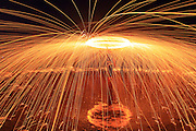RIZHAO, CHINA - JUNE 24: (CHINA OUT) <br /> <br /> Fire Work Art <br /> <br /> A tourist plays with fireworks near the sea on June 24, 2014 in Rizhao, Shandong province of China. this act is known as Fire work art and produces an amazing show<br /> ©Exclusivepix