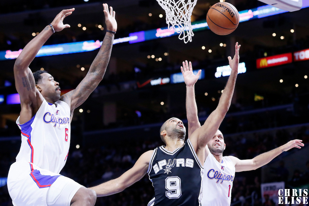 10 November 2014: San Antonio Spurs guard Tony Parker (9) goes for the layup past Los Angeles Clippers center DeAndre Jordan (6) and Los Angeles Clippers guard Jordan Farmar (1) during the San Antonio Spurs 89-85 victory over the Los Angeles Clippers, at the Staples Center, Los Angeles, California, USA.