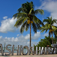 Fashion Harbour at La Isla Shopping Village in Cancun, Mexico<br /> Fashion Harbour is the moniker for the luxury brand section of La Isla Shopping Village. Among the boutique retailers are Louis Vuitton, Emporio Armani, Cartier, Tiffany & Co., H. Stern, Gucci, Salvatore Ferragamo and Lacoste. This sign for Fashion Harbour is a great place for a photo opportunity to share with your winter-bound friends back home.