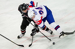 Takuma Kawai of Japan vs Rok Ticar of Slovenia during ice-hockey match between Slovenia and Japan at IIHF World Championship DIV. I Group A Slovenia 2012, on April 16, 2012 in Arena Stozice, Ljubljana, Slovenia. (Photo by Vid Ponikvar / Sportida.com)