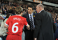 Football - International Friendly Gary Speed Memorial Match - Wales vs. Costa Rica<br /> Wales new manager Chris Coleman shakes the hand of Gary Speeds son Ed before kick off at the Cardiff City Stadium