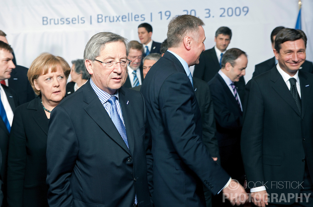 "Jean-Claude Juncker, Luxembourg's prime minister, and Angela Merkel, Germany's chancellor, arrive for the ""family photo"" session, during the European Summit, Thursday, March 19, 2009, in Brussels, Belgium. (Photo © Jock Fistick)"