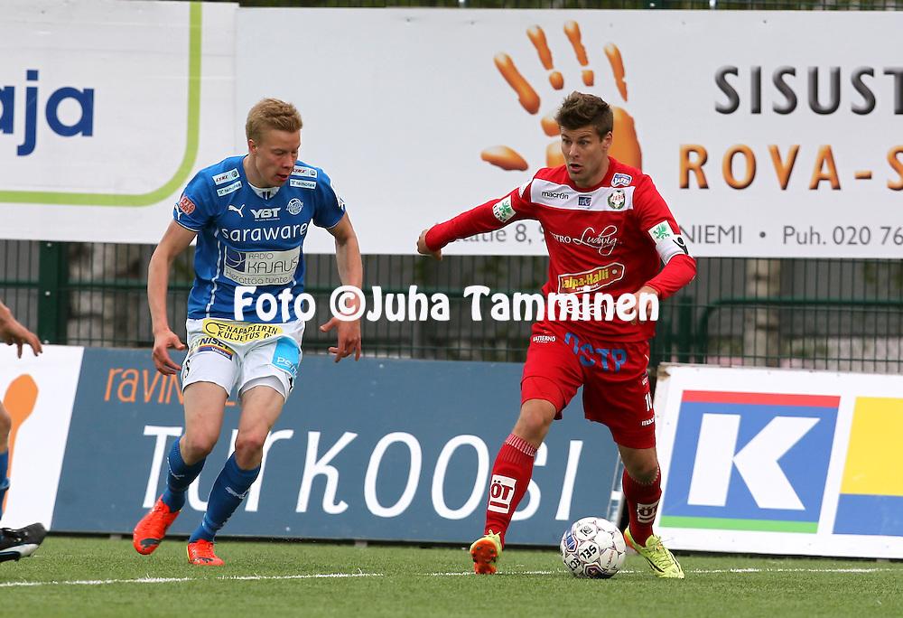 26.5.2014, Keskuskentt&auml;, Rovaniemi.<br /> Veikkausliiga 2014.<br /> Rovaniemen Palloseura - FF Jaro.<br /> Jonas Emet (Jaro) v Jarkko Lahdenm&auml;ki (RoPS).