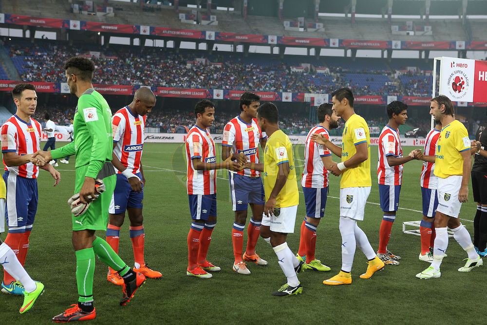 ADK &amp; KBFC players shaking hands after national anthem during match 13 of the Hero Indian Super League between Atl&eacute;tico de Kolkata and Kerala Blasters FC held at the Salt Lake Stadium in Kolkata, West Bengal, India on the 26th October 2014.<br /> <br /> Photo by:  Saikat Das/ ISL/ SPORTZPICS