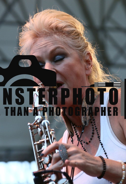 Saxophonist and vocalist Mindi Abair performs in front of a large crowd at the 26th annual duPont Clifford Brown Jazz Festival Friday, June 20, 2014, at Rodney Square Park in Wilmington, DEL.       <br /> <br /> &ldquo;The Clifford Brown Jazz Festival is a staple of Wilmington&rsquo;s performing arts culture,&rdquo; said Mayor Dennis P. Williams. &ldquo;The City is excited to celebrate the 26th anniversary and I hope the community gets involved and enjoys all of the many activities the festival has to offer.&rdquo;<br /> <br /> The Clifford Brown Jazz festival is the largest FREE out door music event on the east coast of the United States.