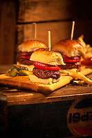 Burger Sliders on a cutting board sitting on old soda crate, fries,veticle