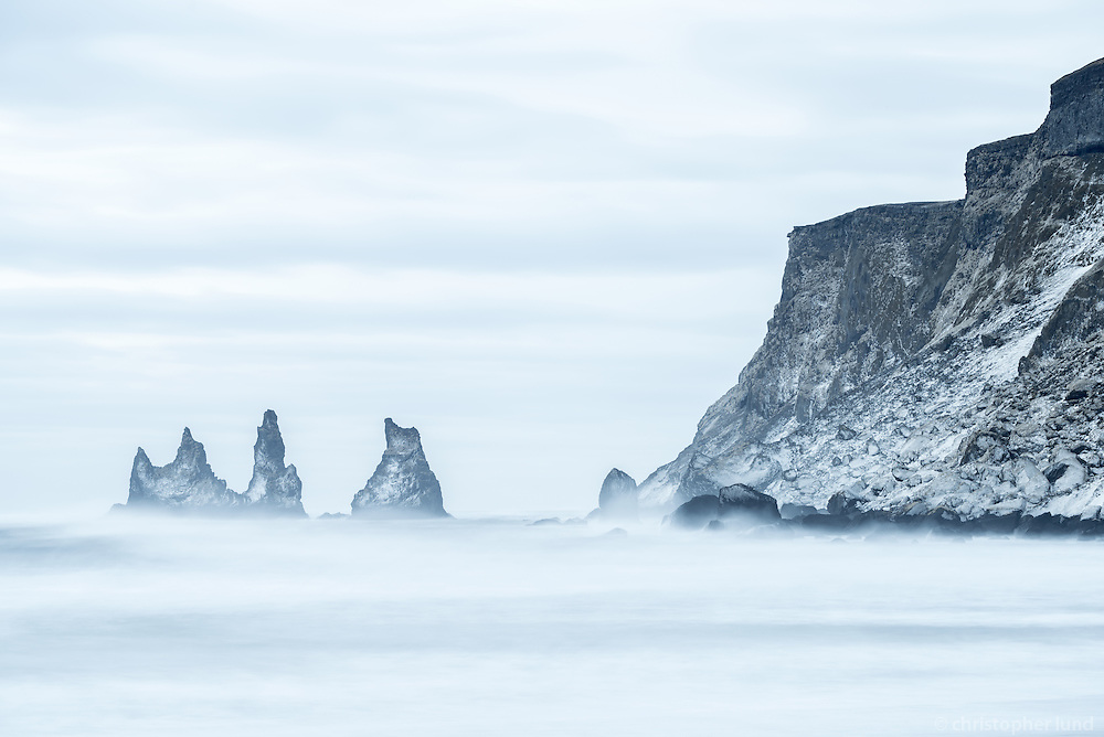 Reynisdrangar viewed from Víkurfjara black sand beach, South Coast of Iceland.