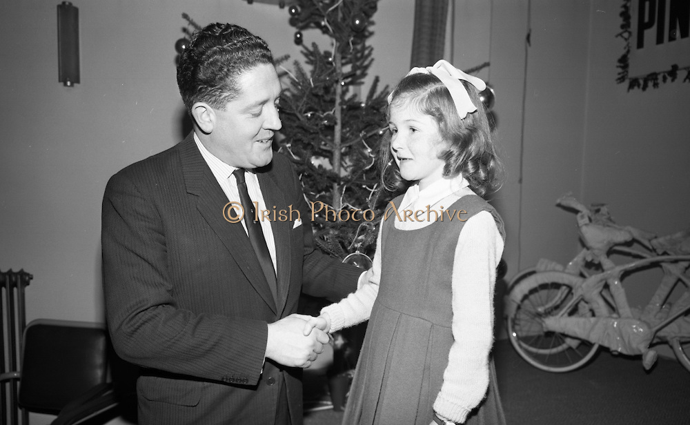 "Presentations at Shell and BP, Fleet Street..1964..18.12.1964..12.18.1964..18th December 1964..At Shell & BP house in Fleet Street, Dublin, the Minister for Justice, Mr Brian Lenihan TD was on hand to present prizes to young winners in ""The Pink Paraffin""competition...Image shows The Minister for Justice, Mr Brian Lenihan TD, congratulating a young prizewinner at the prize giving ceremony. Unfortunately we do not have the childs name, if you know her/him why not let us know at irishphotoarchive@gmail.com."