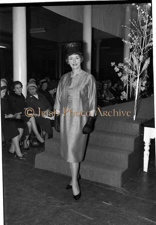 09/03/1964<br /> 03/09/1964<br /> 09 March 1964<br /> McBirney's Fashion show at McBirney's, Aston Quay, Dublin.<br /> Image shows modelMarion wearing tan frock/jacket.
