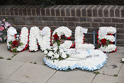 © Licensed to London News Pictures. 29/06/2017. London, UK. Mourners gather and floral tributes ahead of the funeral of Grenfell fire victim Tony Disson. Mr Disson is one of only a handful of the 80 victims to have been identified and named so far. Photo credit: Peter Macdiarmid/LNP