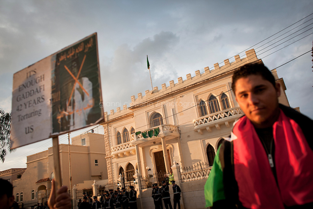 25 February 2011. Valletta, Malta. Libyans living in Malta protest in front of the Libyan embassy. A U.S.-chartered ferry evacuated Americans and other foreigners out of Libya on Friday and brought them to the Mediterranean island of Malta. The Maria Dolores ferry, after three days of delays, brought over 300 passengers, including at 167 U.S. citizens, away from Libya where Colonel Gaddafi's forces continue to clash with anti-government demonstrators.<br /> <br /> <br /> &copy;2011 Gianni Cipriano<br /> cell. +1 646 465 2168 (USA)<br /> cell. +39 328 567 7923<br /> gianni@giannicipriano.com<br /> www.giannicipriano.com