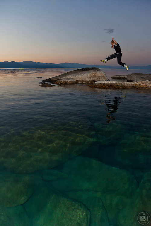 """""""Boy at Lake Tahoe 1"""" - This boy was photographed near Speedboat Beach, Lake Tahoe,  jumping from rock to rock at sunrise."""