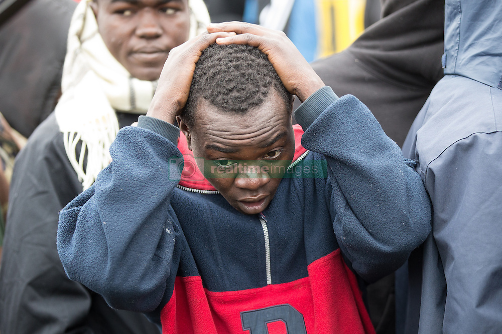 October 24, 2016 - Calais, Calais, France - Calais , France . A crying man in the queue to leave the Jungle migrant camp in Calais , Northern France , on the day of a planned eviction and start of the destruction of the camp  (Credit Image: © Joel Goodman/London News Pictures via ZUMA Wire)