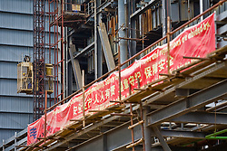 A banner in both Chinese and Vietnamese is hung at the Haiphong Thermal Power Plant construction site in Trung Son, Vietnam, Nov. 22, 2009. Dongfang Electric, a large Chinese contractor, and Marubeni, a Japanese company, won the $500-million contract in 2005. China, famous for its export of cheap goods, is increasingly known around the world for shipping out cheap labor.