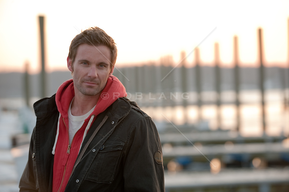 portrait of man at a boat dock