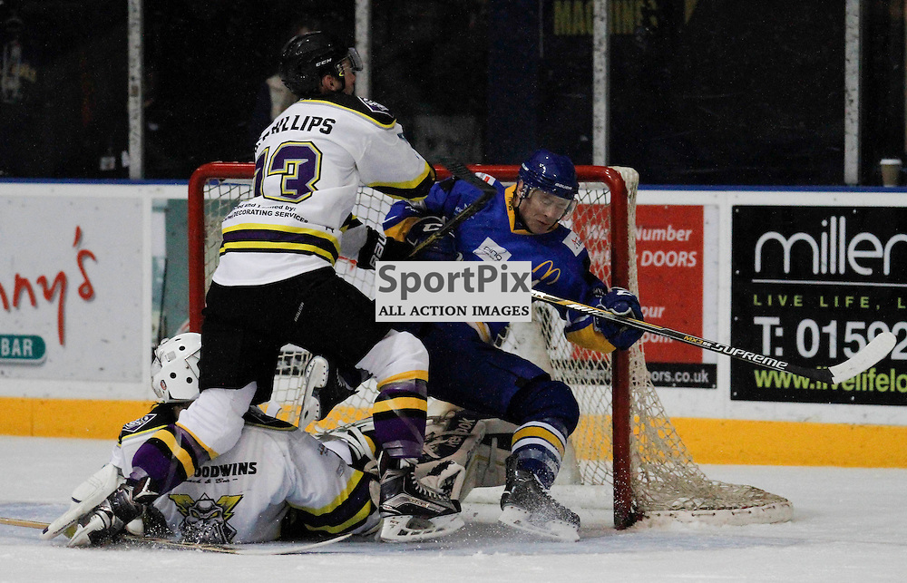 Fife Flyers V Manchester Storm, Elite Ice Hockey League, 2 January 2016, Fife Ice ArenaFife Flyers V Manchester Storm, Elite Ice Hockey League, 2 January 2016, Fife Ice Arena<br /> <br /> FIFE FLYERS #19 GETS PUSHED INTO MANCHESTER STORM NETMINDER #40 ZANE KALEMBA BY MANCHESTER STORM #13 DAVID PHILLIPS WHO ACCIDENTALLY PUT HIS KNEE INTO HIS NETMINDER