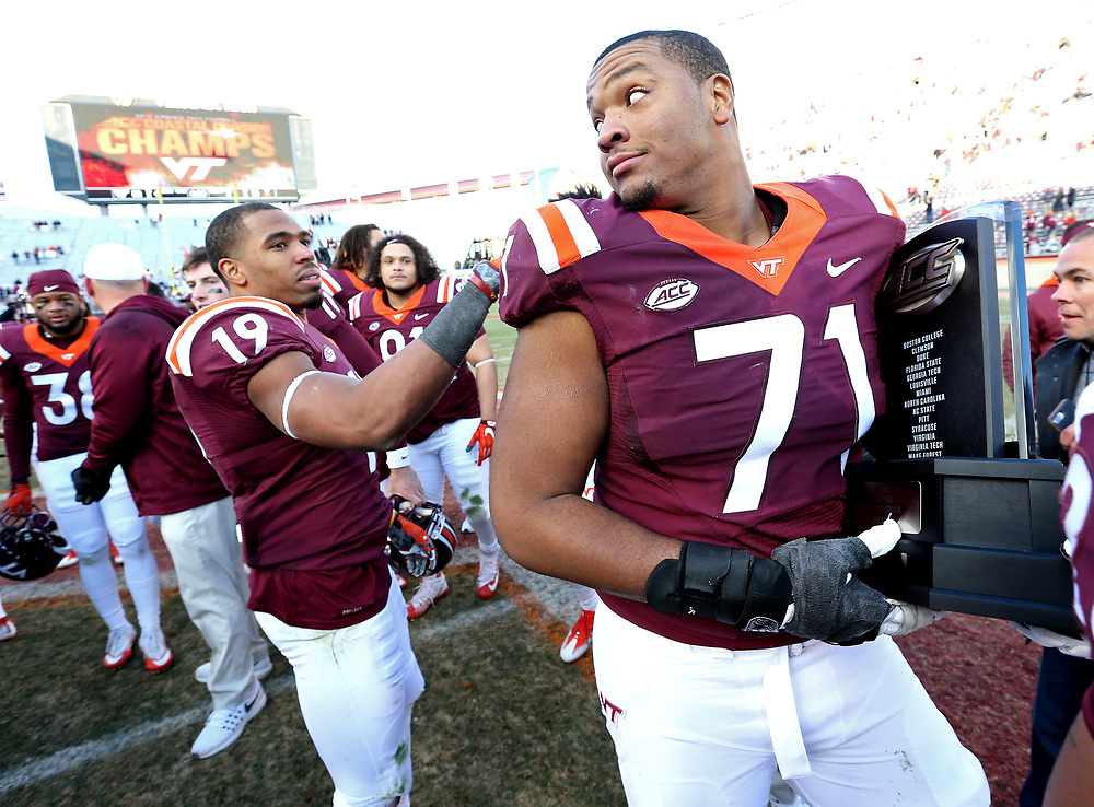 Nov 26, 2016; Blacksburg, VA, USA;  Virginia Tech Hokies offensive lineman Jonathan McLaughlin (71) celebrates with the ACC Coastal Division Championship Trophy after beating the Virginia Cavaliers at Lane Stadium. Mandatory Credit: Peter Casey-USA TODAY Sports
