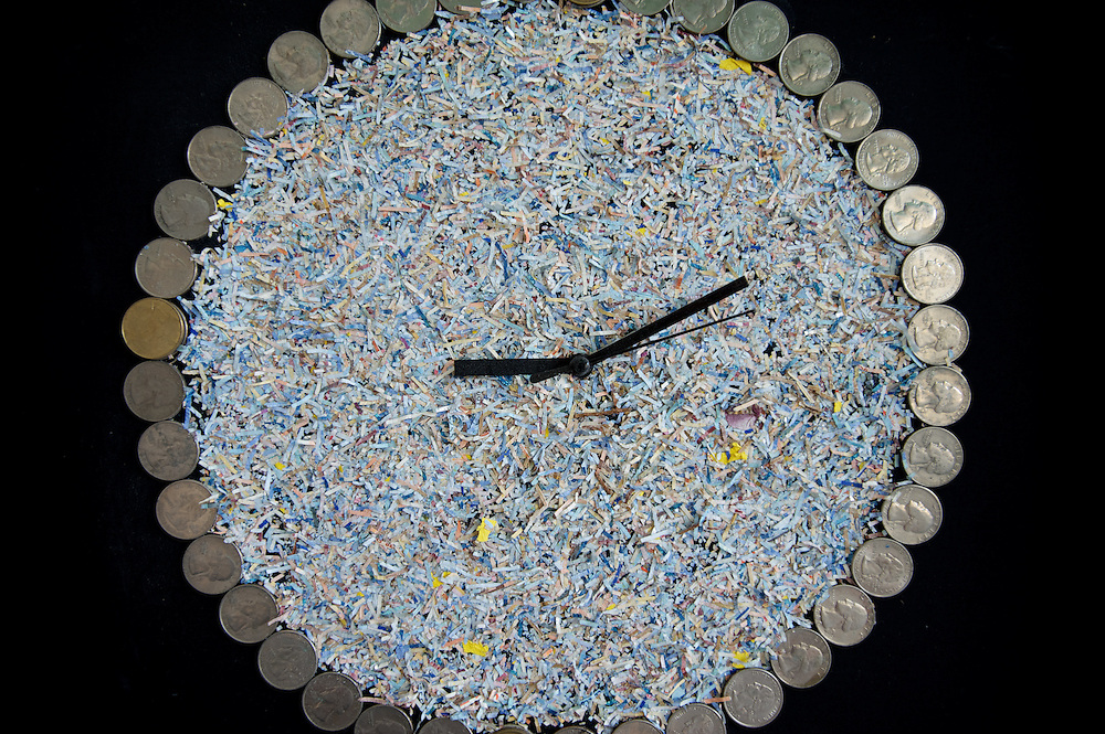 March 27, 2012 - Dublin, Ireland: A wall clock made of shredded money is displayed at the Billion Euro House art installation by the Irish artist Frank Buckley. ..Worthless euros, taken out of circulation and shredded by Irelands Central Bank, formes the interior walls of an apartment that Mr. Buckley does not own in a building left vacant by the countrys economic ruin...The artist decided to call the apartment  built from thousands of bricks of shredded, decommissioned cash (each brick contains, roughly, what used to be 50,000 euros)  the Billion Euro House. He reckons that about 1.4 billion euros actually went into it, but the joke, of course, is that it is worth simultaneously so much and so little...A large gravestone beside the main door, announces that Irish sovereignty died in 2010, the year that the government accepted an international bailout so larded with onerous conditions that the Irish will be paying for it for years to come. (Paulo Nunes dos Santos/Polaris)