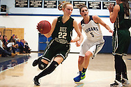 Rice forward Lizzy Lyman (22) drives to the hoop past Mount Mansfield forward Perry Willett (5) during the girls basketball game between the Rice Green knights and the Mount Mansfield Cougars at MMU High School on Friday night December 4, 2015 in Jericho. (BRIAN JENKINS/for the FREE PRESS)