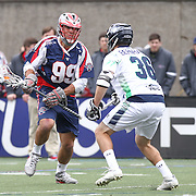 Paul Rabil #99 of the Boston Cannons looks to get past Jesse Bernhardt #36 of the Chesapeake Bayhawks during the game at Harvard Stadium on April 27, 2014 in Boston, Massachusetts. (Photo by Elan Kawesch)