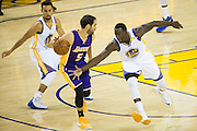 Golden State Warriors forward Draymond Green (23) reaches for a steal against the Los Angeles Lakers at Oracle Arena in Oakland, Calif., on November 23, 2016. (Stan Olszewski/Special to S.F. Examiner)