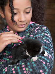 Girl stroking a kitten