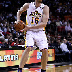 March 10, 2011; Miami, FL, USA; Los Angeles Lakers power forward Pau Gasol (16) against the Miami Heat during the first quarter at the American Airlines Arena.  Mandatory Credit: Derick E. Hingle