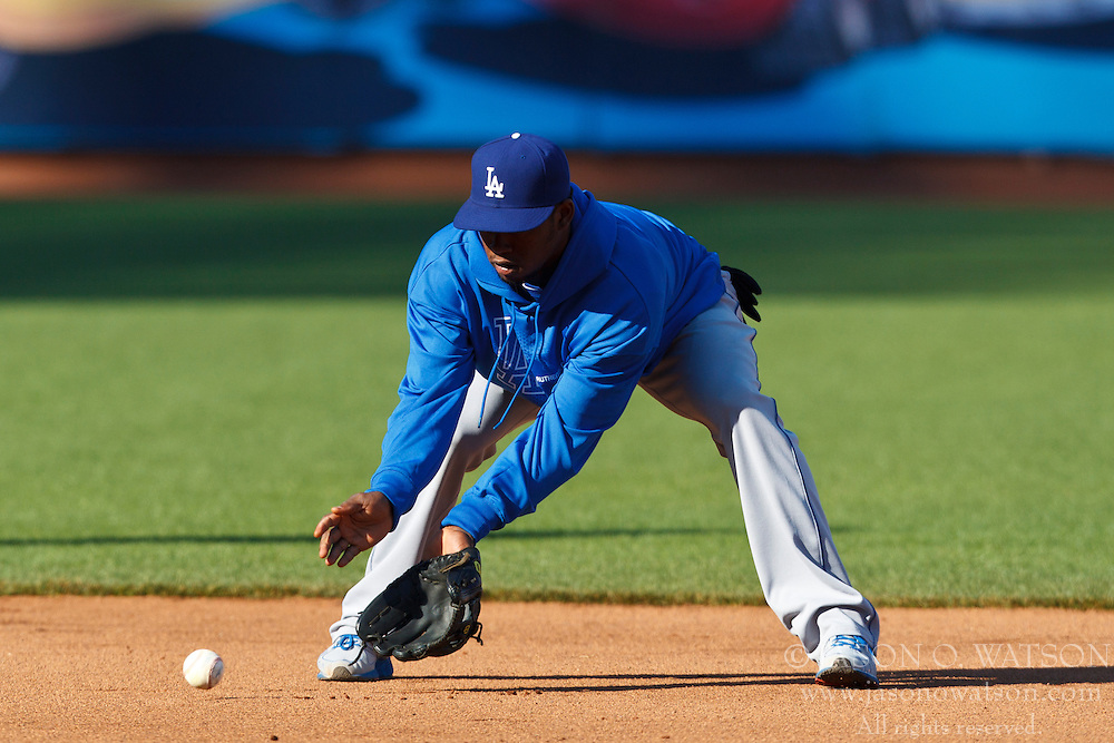 SAN FRANCISCO, CA - JULY 27: Hanley Ramirez #13 of the Los Angeles Dodgers fields a ground ball during batting practice before the game against the San Francisco Giants at AT&T Park on July 27, 2012 in San Francisco, California. The Los Angeles Dodgers defeated the San Francisco Giants 5-3 in 10 innings. (Photo by Jason O. Watson/Getty Images) *** Local Caption *** Hanley Ramirez